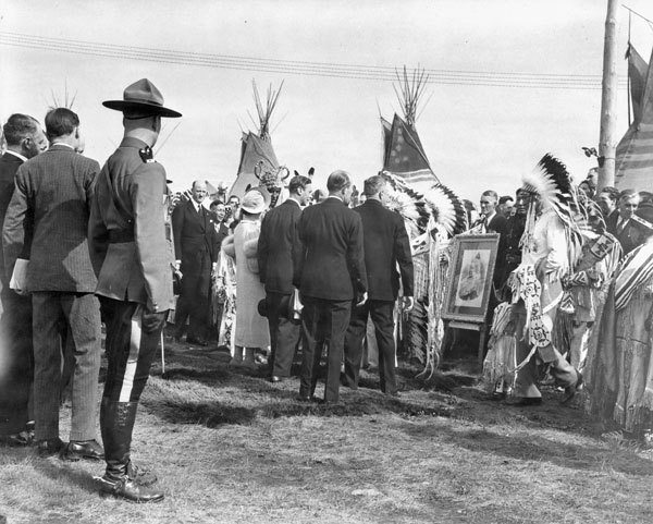 """""""Their Majesties greet chieftains of the Stoney Indian Tribe, who have brought a photo of Queen Victoria."""" Calgary, Canada, May 26, 1939  Photo: Library and Archives Canada"""