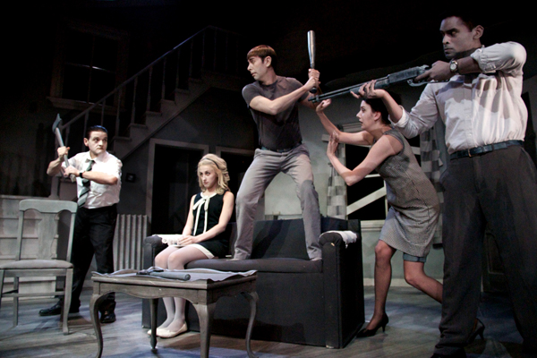 """The Night of the Living Dead Live"" is an homage to the original film, down to the black and white makeup and set design. From left to right: Tom (Andrew Fleming), Helen Cooper (Dale Boyer), and Ben (Darryl Hinds) onstage.  Photo courtesy of The Night of the Living Dead Live."