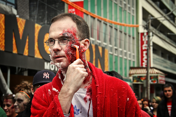 A zombie scrapes skin off his face during a close shave with death at the 2012 Zombie Walk. Photo: Jackman Chiu courtesy TZW.
