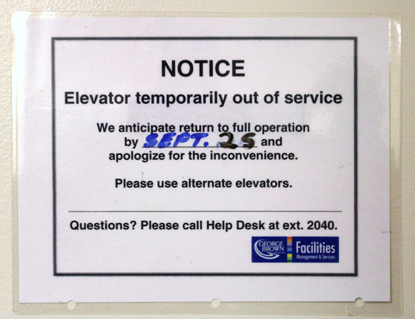 The dates on the signs change, but the elevators at GBC stay out of service. Photo: Preeteesh Peetabh Singh