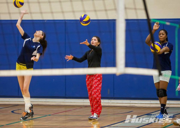 Members of George Brown's women's volleyball team warm up for the Pyjama Ball tournament which raised over $500 for the Children's Wish Foundation. Photo: Thomas Chung/GBC Athletics