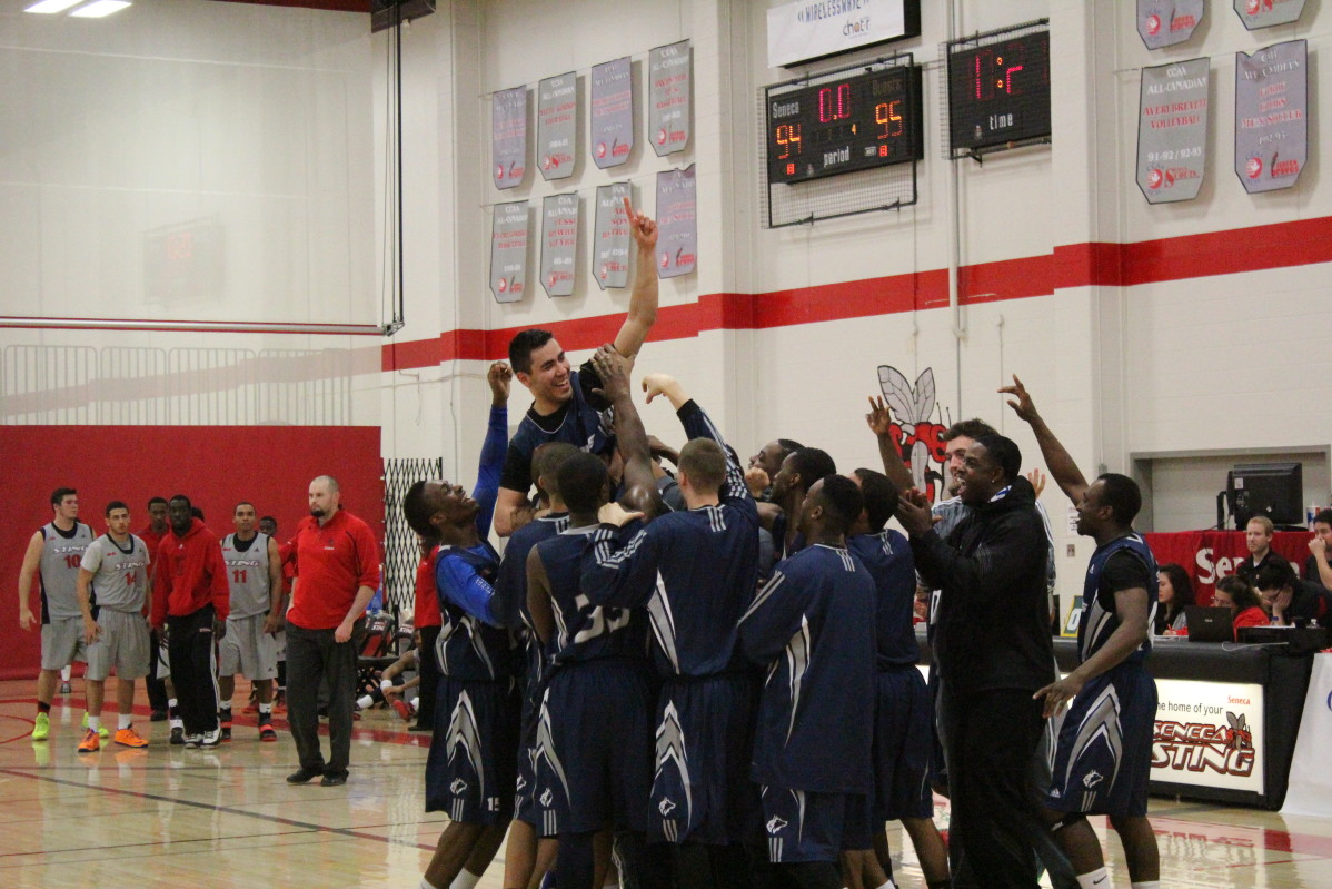 Vadim Halimov is lifted into the air by his teammates after sinking the winning basket with one second left and smashing two OCAA records in the process. Photo: Brittany Barber/The Dialog