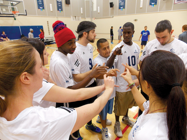 GBC dodgeball players huddle and psych themselves up before a game. Photo: Alena Khabibullina/The Dialog