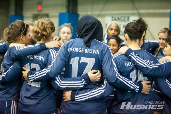 The women's indoor soccer team huddles up. Photo: Thomas Chung/GBC Athletics