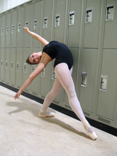 Dance student Mallory Hodgson does a back bend in the hallway at Casa Loma campus. Photo: Rachel Levitt/The Dialog