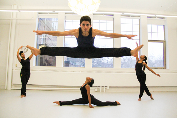 jumps while other students strike ballet poses at Inica Dance Industries. Photo: Preeteesh Peetabh Singh/The Dialog