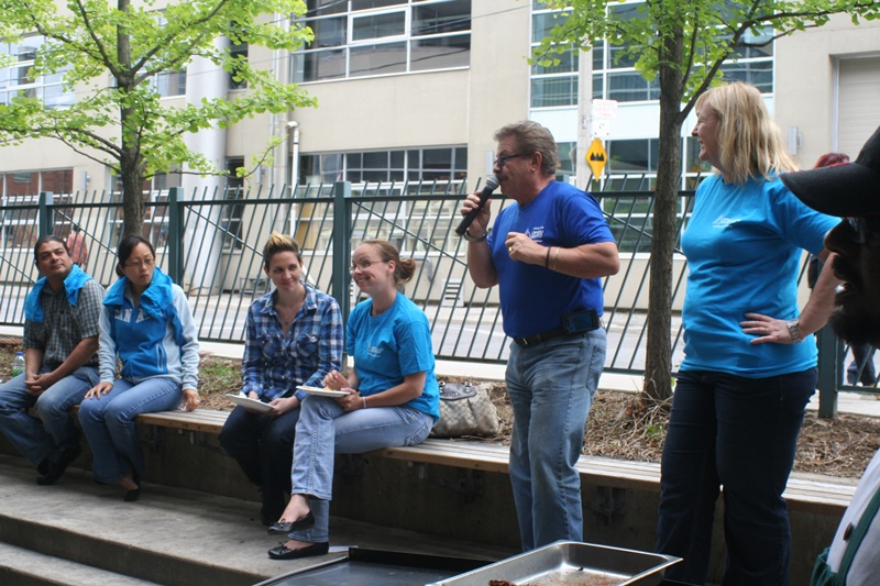 Tom Tomassi, president of the faculty local at George Brown College, speaks to members at a BBQ at Casa Loma campus in the summer of 2014. Photo courtesy OPSEU.