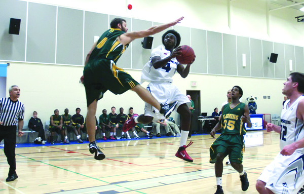 Frankie Gyamfi, centre in the #4 jersey, was the men's basketball MVP in 2011. Photo courtesy of GBC athletics.