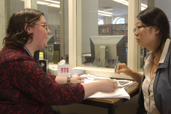 Ashlee Chatten (left) works on pronunciation with a student at the St. James TLC.
