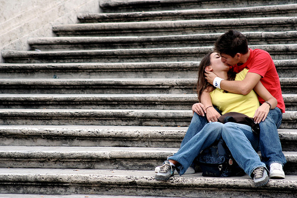 Photo of a man and a woman kissing on steps. Photo: CC BY 2.0 via Flickr user Jon Rawlinson
