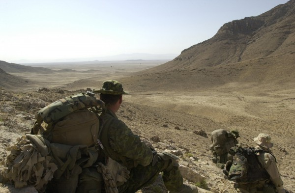 Canadian soldiers from 3PPCLI take a break as they move into the hills to search for Alqueda and Taliban fighters after an air assault onto an objective north of Qualat, Afghanistan on July 1, 2002. The soldiers are participating in Operation Cherokee Sky, an operation to locate and destroy remaining pockets of Al Queda and Taliban in support of Operation Enduring Freedom. (U.S. Army photo by Staff Sgt. Robert Hyatt) (Released)