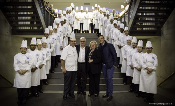 From right to left: Chef Higgins, Chef Alain Ducasse, Dean Lorraine Trotter, Chef Chuck Hughes with Chef School faculty and staff at the background. Photo courtesy of George Brown College.