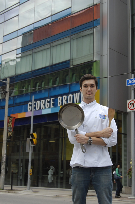 Ross Constandse stands in front of the George Brown College Culinary Arts and Hopsitality building Photo: Dora Liu/The Dialog