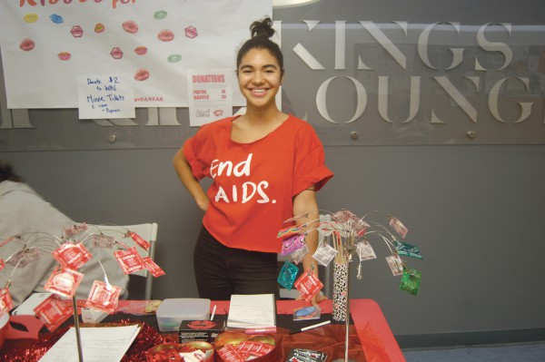 Louise Boileau, campaigns staff for the Student Association works the Kisses4CANFAR table at St. James campus. Photo: Tina Todaro/The Dialog