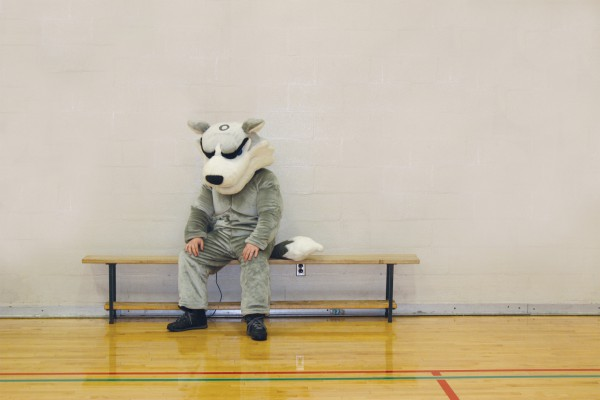 Photo of the Huskies mascott sitting on a bench by themselves: Brittany Barber