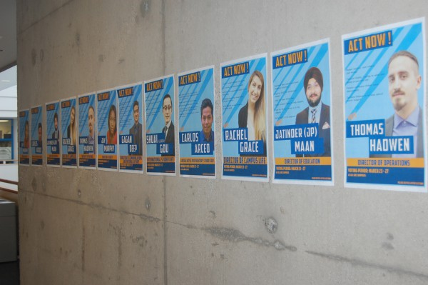 On Wednesday the CRO issued the Student Voice candidates 12 demerit points for various poster infractions including slate posters posted right next to each other. Photo of ACT Now! posters at Casa Loma campus by Tina Todaro/The Dialog