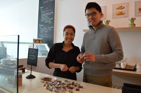 Bruce Lee and Stephanie Duong enjoy rolling caramel treats together Photo: Dora Liu/The Dialog
