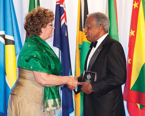 Anne Sado, President of George Brown College receives Chancellor's Award from UWI Chancellor Sir George Alleyne Photo: INRphotography.com