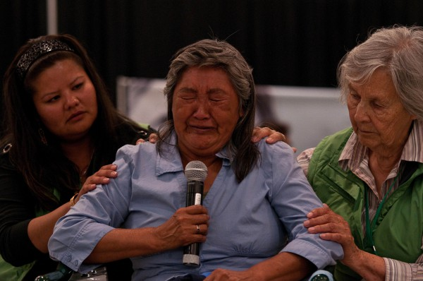 A woman cries as she speaks to the Truth and Reconciliation Commission in Inuvik on July 1, 2011. Photo: <a href=https://www.flickr.com/photos/mmmswan/5911809791/in/album-72157627138390564/>Michael Swan, Flickr</a> (CC BY-ND 2.0)