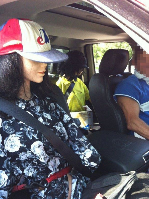 Toronto Police charged a man for driving in an HOV lane with two mannequins as passengers. Photo: Toronto Police.