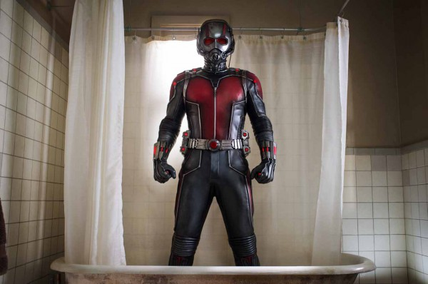 Image of Ant Man the superhero of the movie in his  Red and Grey Costume standing in a bathtub