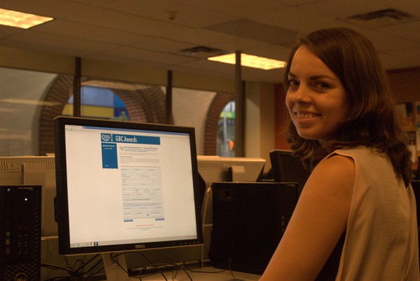 A photo of Kateryna Barylko in front of a computer screen applying for the GBC Awards Program at the St. James Campus