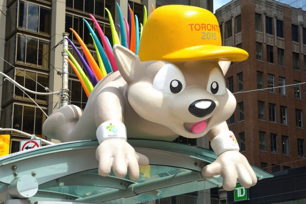 Image of Pachi the porcupine, the mascot for the Toronto 2015 Pan Am/Parapan Am Games dancing in crowd with celebrations for event