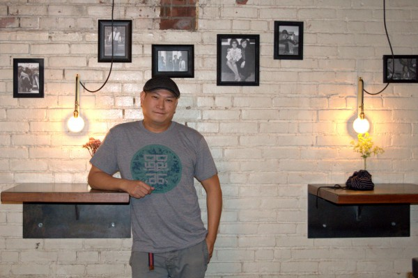 Image of Nick Liu at the DaiLo restaurant in a t-shirt with its logo