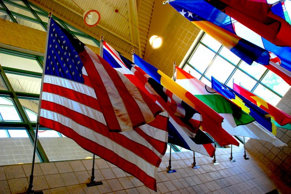 Image of flags of different countries hanging on the wall