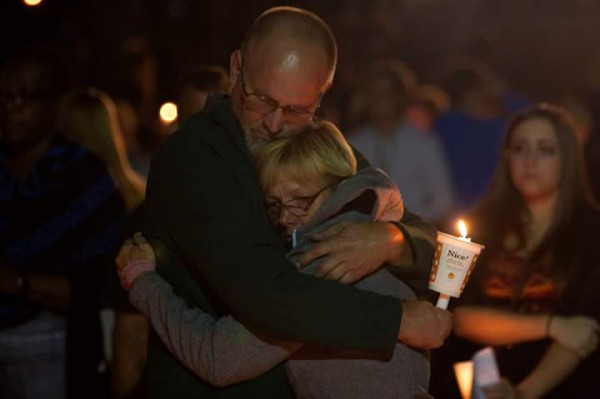 Two people embrace at a vigil at Umpqua Community College where 10 people were killed on Thursday by a lone gunman. Photo: Justin Pittman / Umpqua Community College Mainstream Newspaper