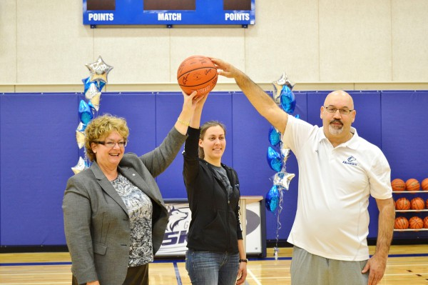 Image of Anne Sado, Melaine Gerin-Lajoie and Albert DaSilva holding the basket ball up together