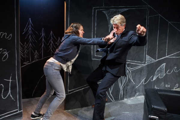 "Image of Laura Condlln pushing Rick Roberts in an act from the play ""An Enemy of the People"", at the Tarragon Theatre"