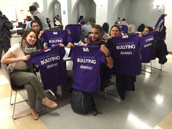 Image of Students with stop bullying campaign t-shirts in violet color
