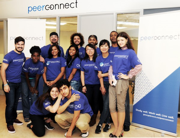 image of students of peer connect team standing together infront of the office of peerconnect