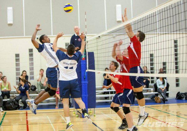 Image of George Brown Volleyball team in a game