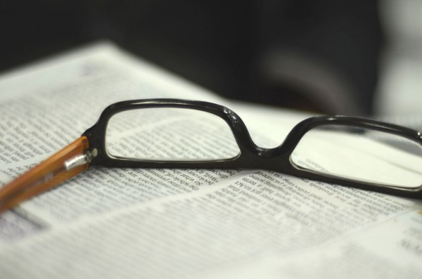 Image of a pair of glasses on a newspaper