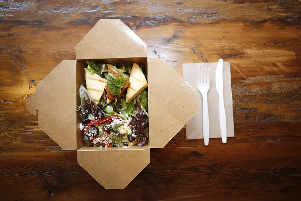 Photo of a take away box with salad in it courtesy of Food Evolution Co.
