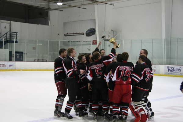 Image of St. Lawrence Sharks celebrates their win in the George Brown Extramural hockey tournament on Oct 30.