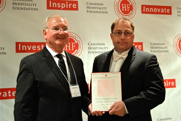 Image of Joseph Douglas is receiving an award from Paul Glover, a chair of CHF at the gala event