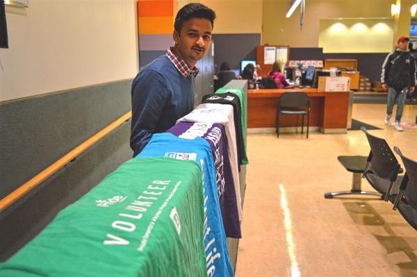 Image of Shekhar Baid with his coloured volunteering T-Shirts