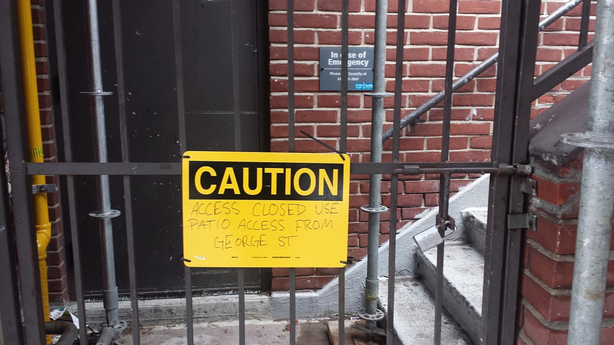 Image of Staircase sealed with bars and a caution notice