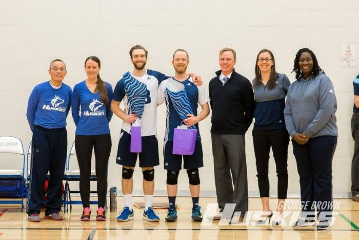 Huskies volleyball players Oscar Kahu and Josh Taylor, pictured here with GBC athletics staff, have been playing together since grade 8. Photo courtesy of George Brown College.