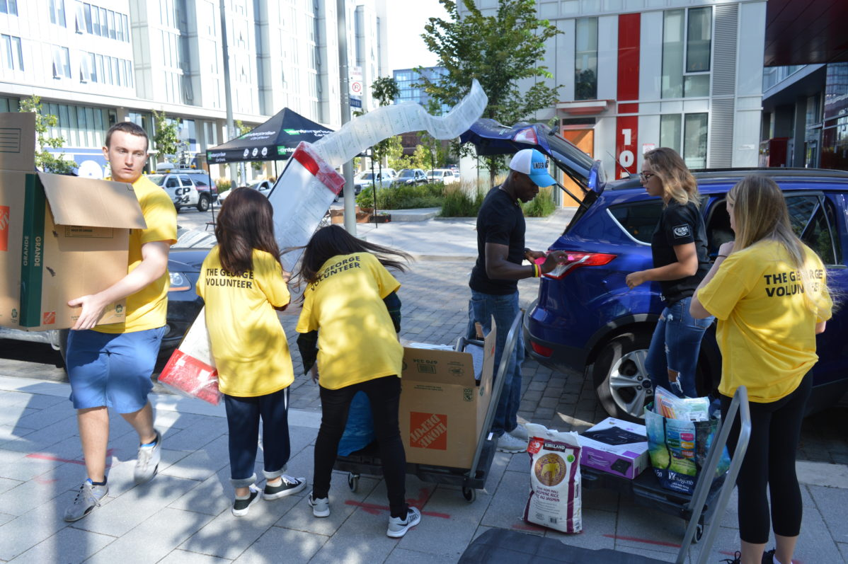 Students line-up to move into George Brown's first residence, The George
