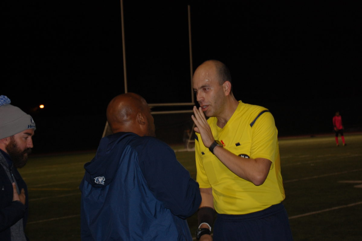 George Brown Huskies head coach John Williams argues with the referee
