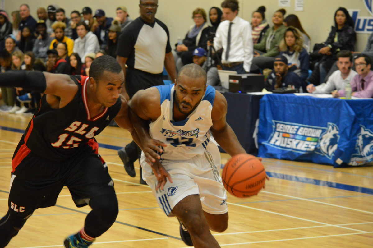 George Brown Huskies guard Ajahmo Clarke dribbles to the net.