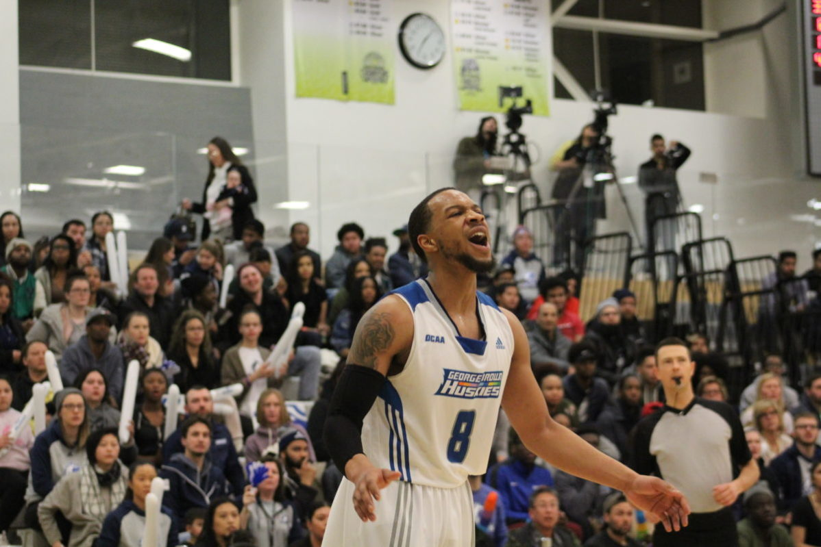 Kevon Mascoe misses a three-point shot in the gold medal game against Sheridan on March 4. Sheridan won 76-74 in the final seconds. Photo: Philip Iver / The Dialog