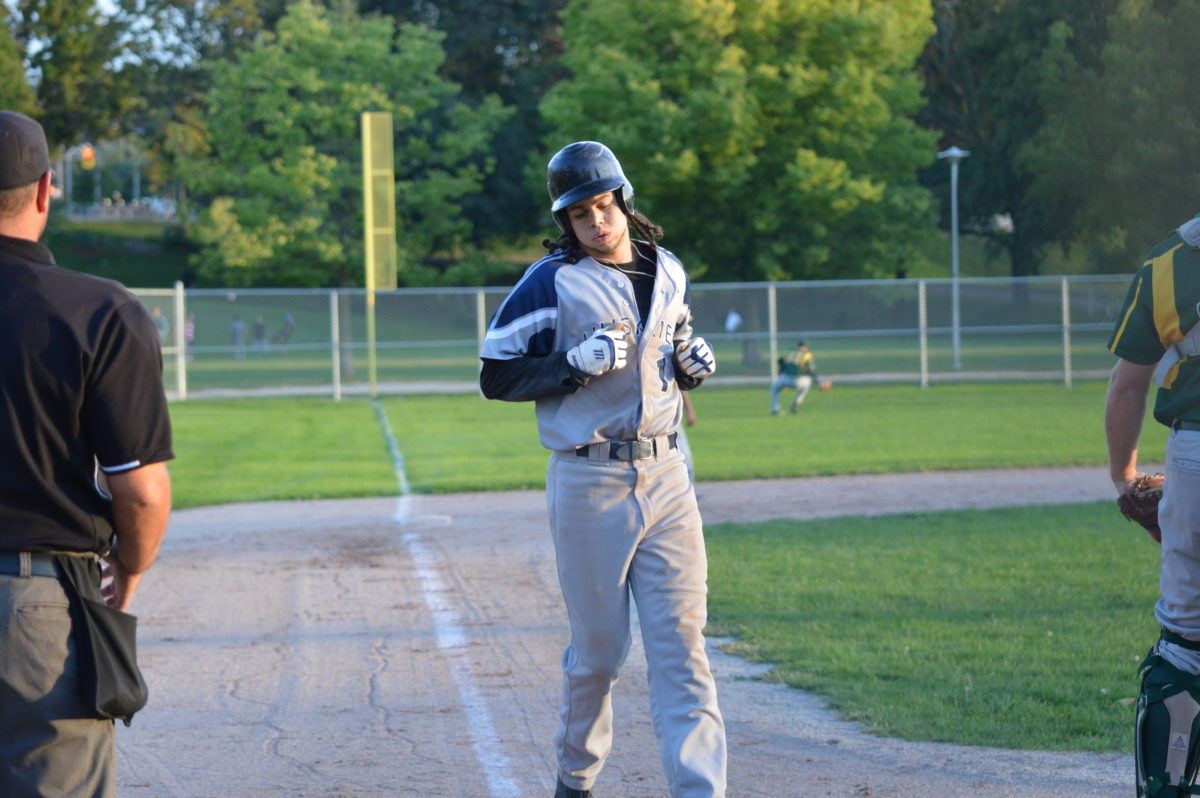 Andrew Murrell brings home a run for the George Brown Huskies baseball team. File Photo: Philip Iver / The Dialog
