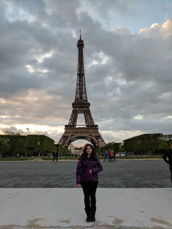 The Dialog's Kelsey Rambaran stops for a quick photo in front of the Eiffel Tower in Paris on at GBC study abroad trip in April.