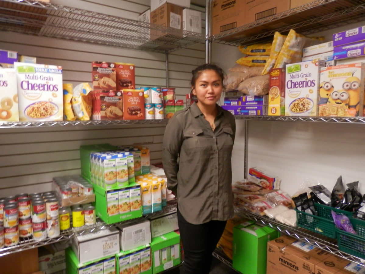 Ronnie Cruz, Community Services Coordinator at the Student Association, showed us the donations received at GBC's food bank. Photo: Natalia Pizarro Silva/The Dialog