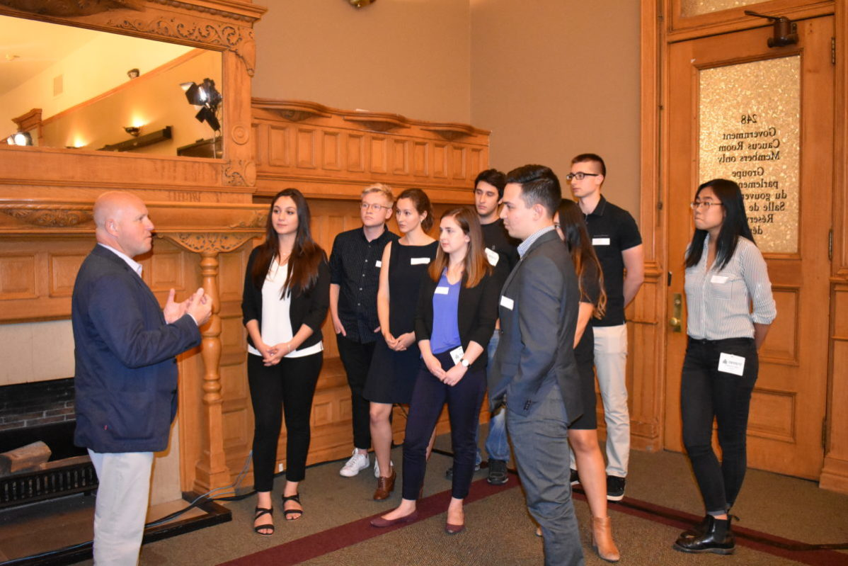 Minister of Housing, Peter Milczyn in conversation with students about rental issues. Photo: Mansha Rupani / The Dialog